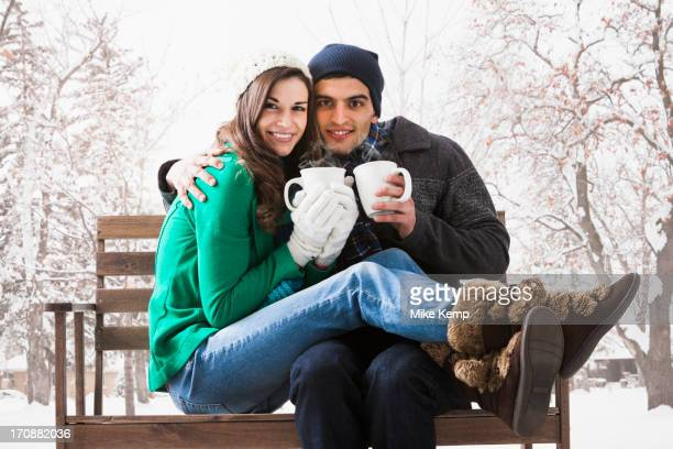 Couple having coffee together in snow