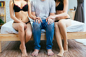 Couple having complicated affair and love triangle in bedroom