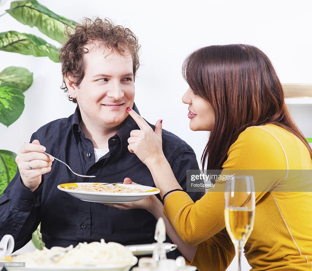 Couple having dinner at home : Stock Photo
