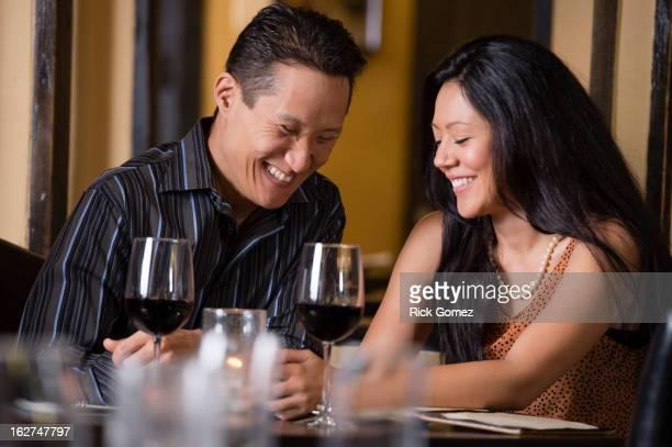 Couple having dinner together in restaurant