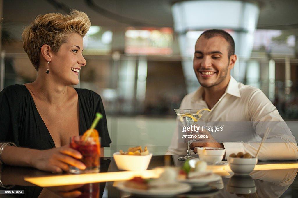 Couple having drinks at bar : Stock Photo