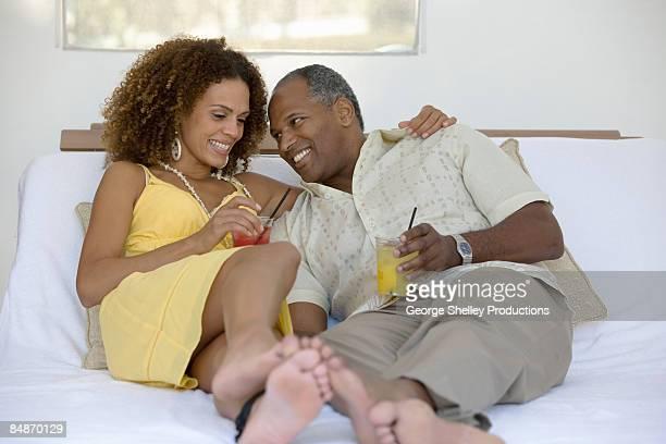 Couple having drinks in a resort cabana