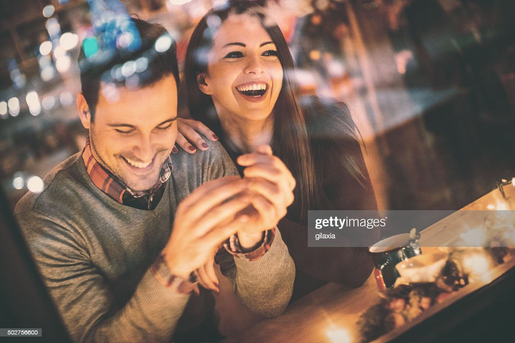Couple having fun at coffee house. : Stock Photo