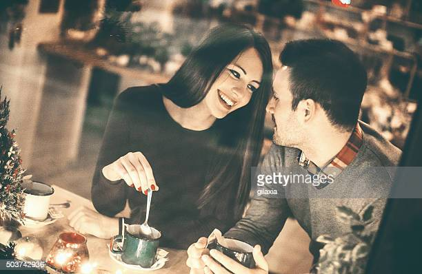 Couple having fun at coffee house.