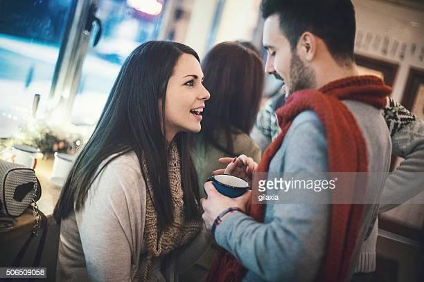 Couple having fun at coffee house.