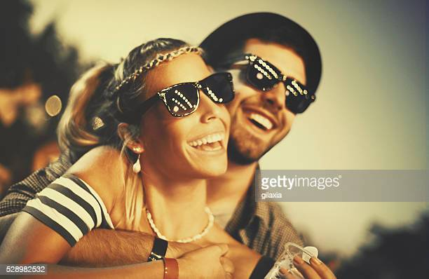 Couple having fun at concert.