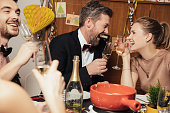 Couple having fun at New Years Eve party