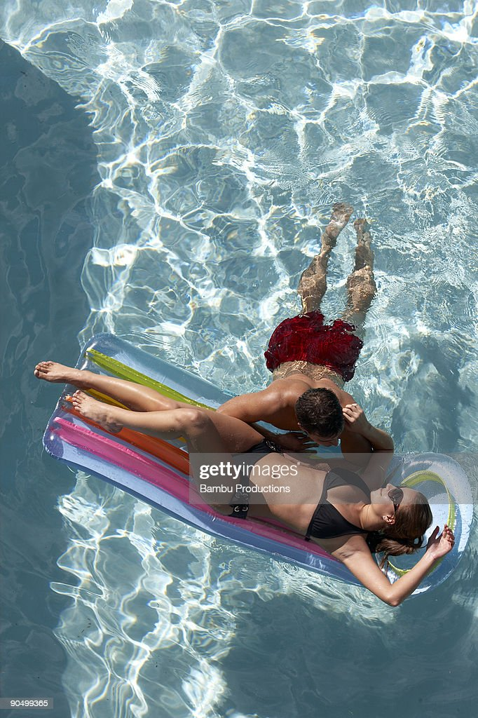 Couple Having Fun At The Swimming Pool Stock Photo Getty Images