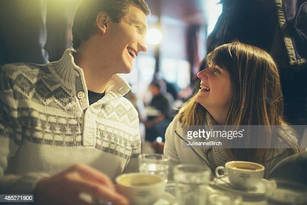 Couple having fun in a coffee bar