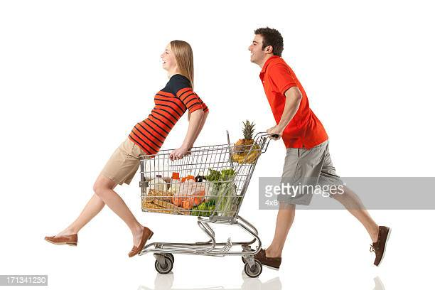 Couple having fun in a supermarket