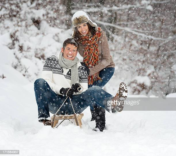 Couple having Fun on a Sled, Real Snowflakes, Winter Wonderland