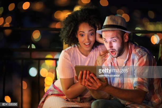 Couple having fun on street