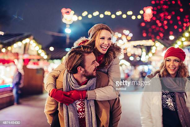 Couple having fun outdoors at winter fair.