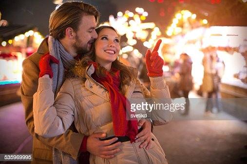 Couple having fun outdoors at winter fair. : Stock Photo