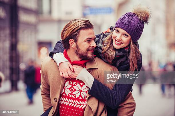 Couple having fun outdoors in winter city.