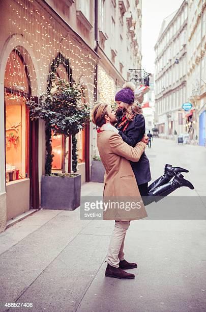 Couple having fun outdoors in winter city.