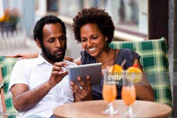 Couple having fun with digital tablet