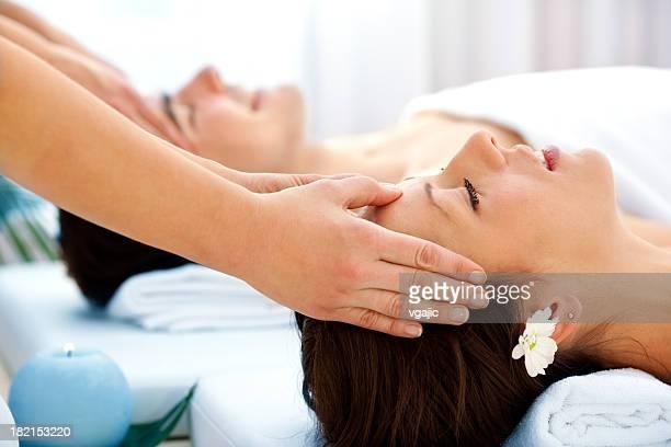 Couple Having Head Massage At Spa Center