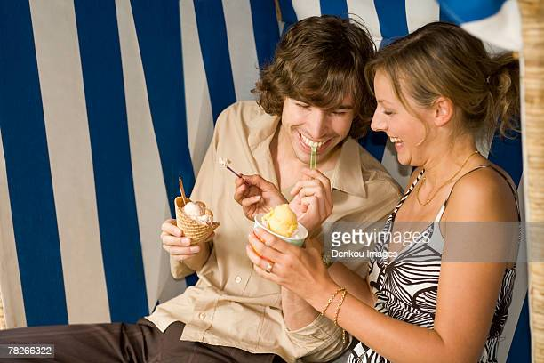 A couple having ice cream.