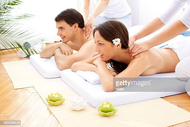 Couple Having Massage At Spa Center