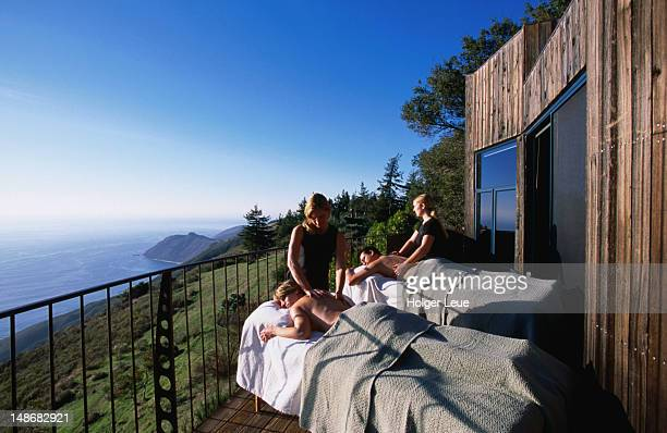 Couple having massage outdoors at Post Ranch Inn, Big Sur.