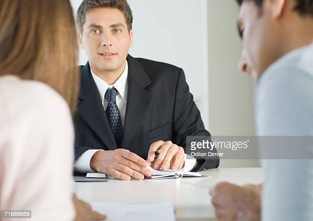 Couple having meeting with businessman