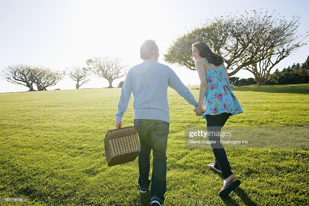 Couple having picnic in park : Stock Photo