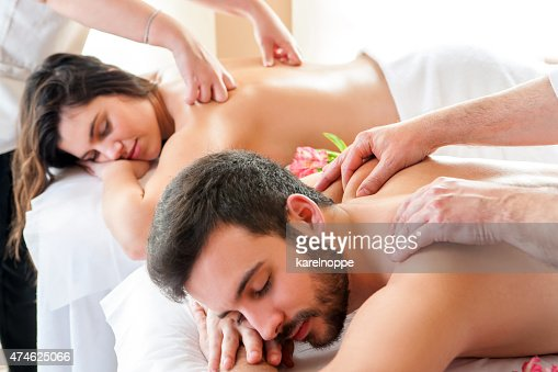 Couple having relaxing body massage in spa. : Stock Photo