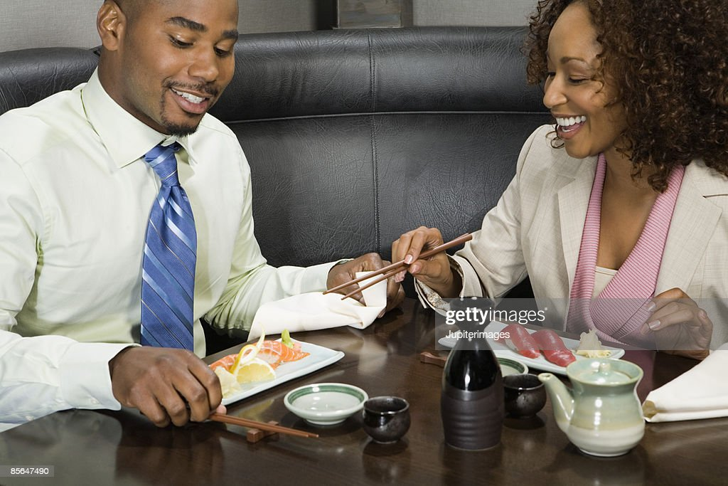 Couple having sushi dinner : Stock Photo