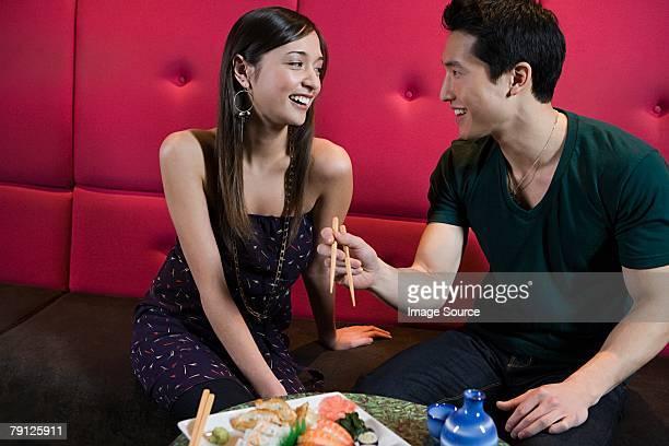 Couple having sushi