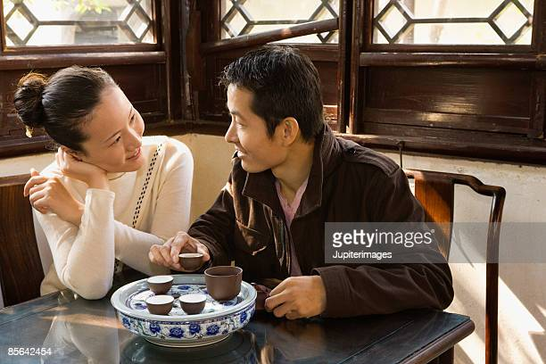Couple having tea together