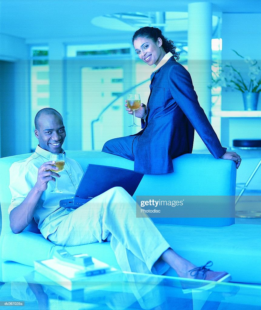 Couple having wine at home : Stock Photo
