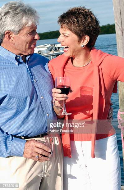 Couple having wine at marina