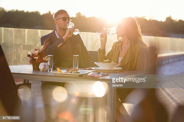 Couple having wine in outdoor restaurant