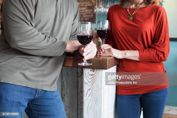 Couple having wine together at bar