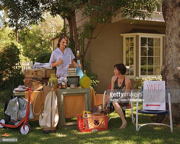 Couple having yard sale