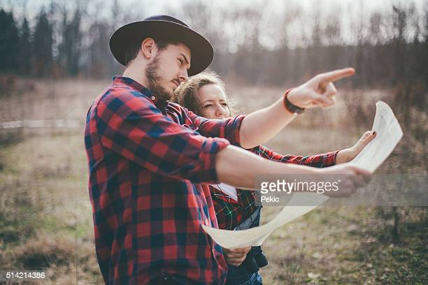 Couple Hikers making a plan with a hiking map