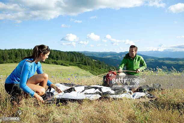 A couple hiking and camping.