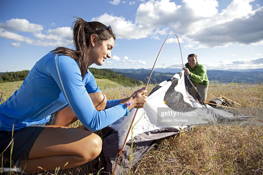 A couple hiking and camping. : Stock Photo