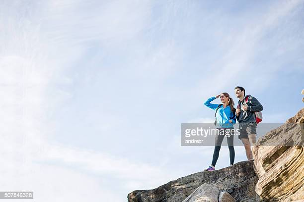 Couple hiking and looking at the view
