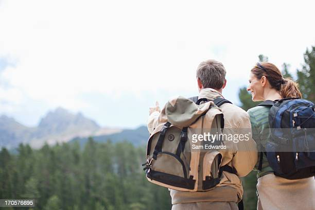 Couple hiking and looking in remote area