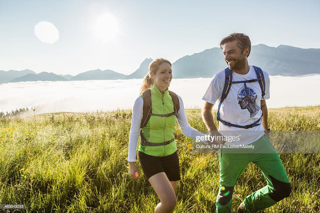Couple hiking in mountains, Tyrol, Austria