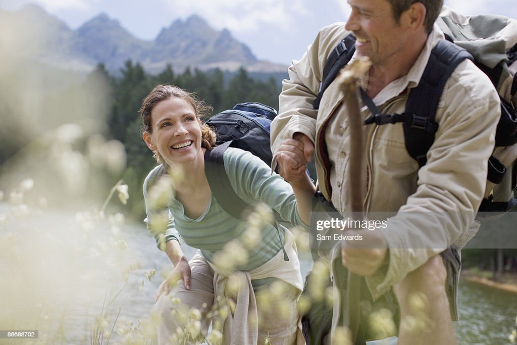 Couple hiking in remote area : Stock Photo