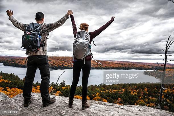Couple hiking on the mountain peak