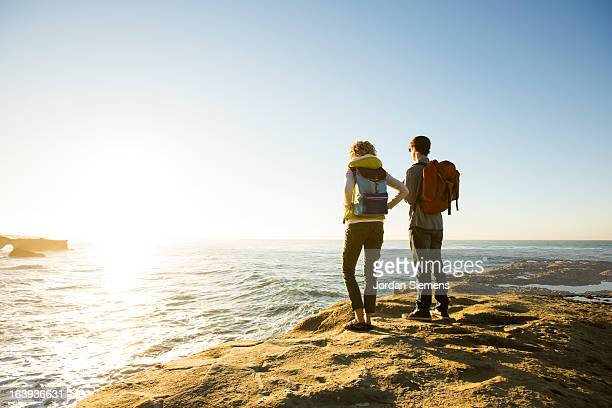 A couple hiking the California coast.