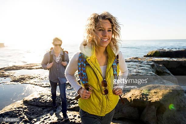 A couple hiking the California coast.