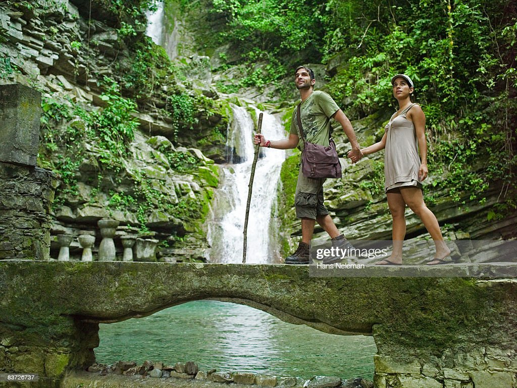 Couple hiking through remote jungle : Stock Photo