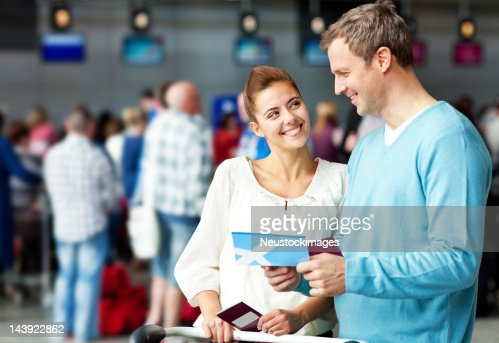 Couple Holding a Boarding Pass : Stock Photo