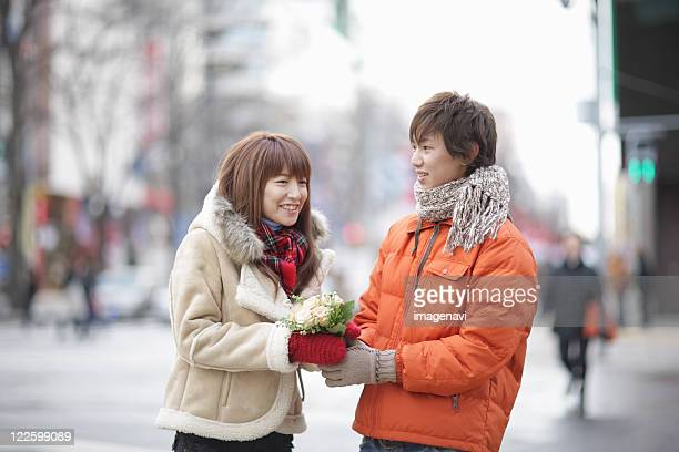 Couple holding a bouquet