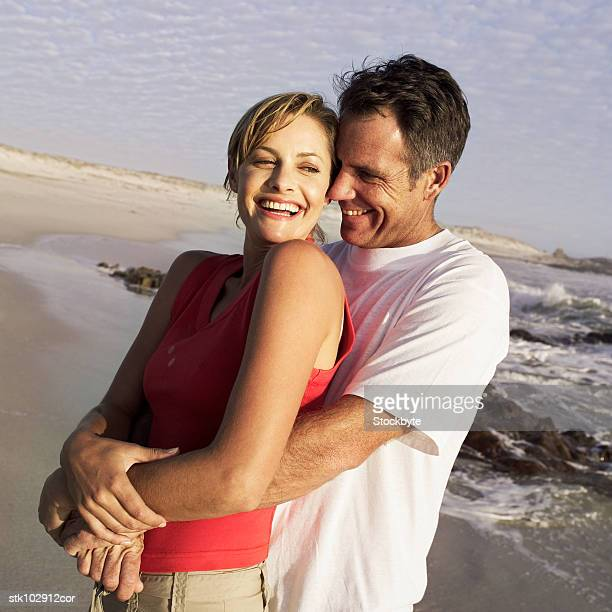 couple holding each other at the beach